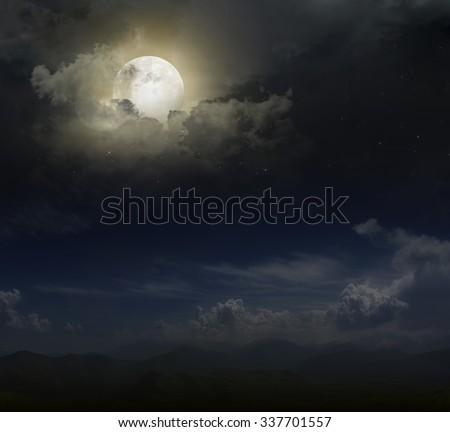 Moon over mountain peaks - stock photo