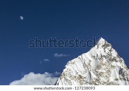 Moon over Nuptse (7864 m) at sunset (view from Kala Patthar) - Everest region, Nepal, Himalayas - stock photo