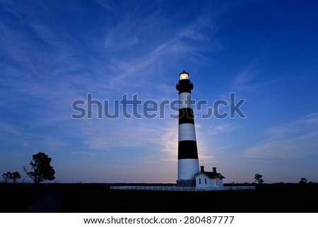 Moon Rising Behind Bodie Lighthouse - stock photo