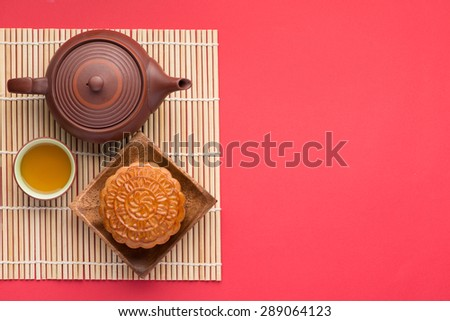 Mooncake and tea,Chinese mid autumn festival food. angle view from above - stock photo