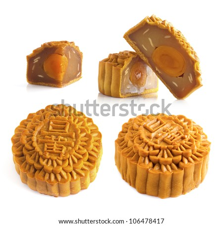Mooncake traditionally eaten during the Mid-Autumn Festival. Chinese words on the mooncake means single yolk. - stock photo