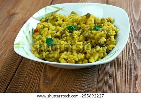 moong dal khichdi - traditional Indian dish called khichdi - stock photo