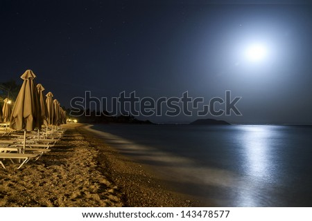 moonlight over the sea and the beach - stock photo
