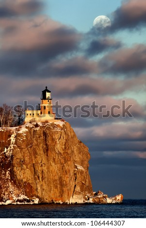 Moonrise and sunset at Split Rock Lighthouse, North Shore of Lake Superior, Minnesota (vertical) - stock photo