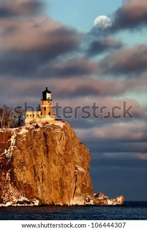 Moonrise and sunset at Split Rock Lighthouse, North Shore of Lake Superior, Minnesota (vertical) - stock photo