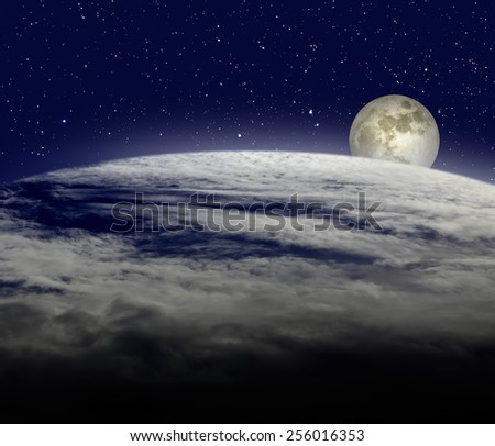 Moonrise over cloudy earth planet - stock photo
