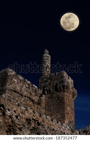 Moonrise over David's tower (citadel) - the old city of Jerusalem (Israel) - stock photo
