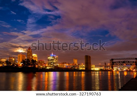Moonrise over downtown Cleveland, Ohio, seen from the mouth of the Cuyahoga River - stock photo