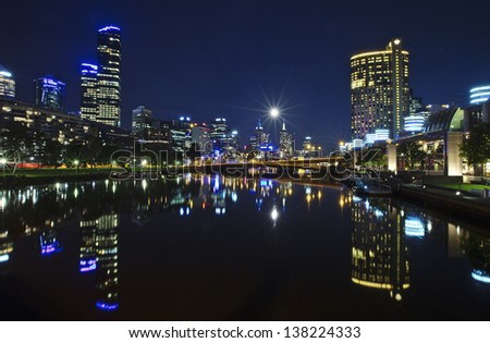 Moonrise over Melbourne City - stock photo