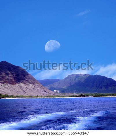 Moonrise over Small village with large hotel Oahu Hawaii - stock photo