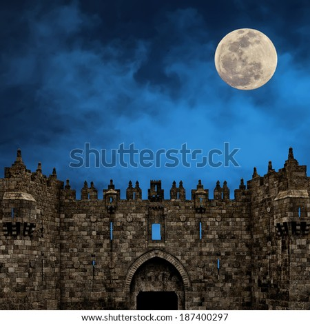 Moonrise over the Damascus Gate  -  the Old city of Jerusalem (Israel) - stock photo