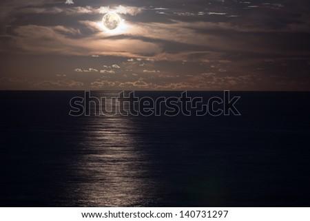 Moonrise over the ocean, Australia - stock photo