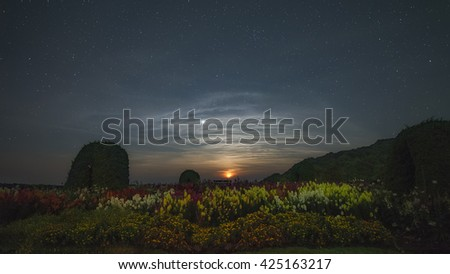 Moonset after the flower garden and stars, mountain Inthanon Chiangmai, Thailand - stock photo