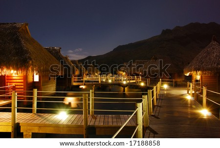 Moorea Bungalows over Lagoon at Night - stock photo