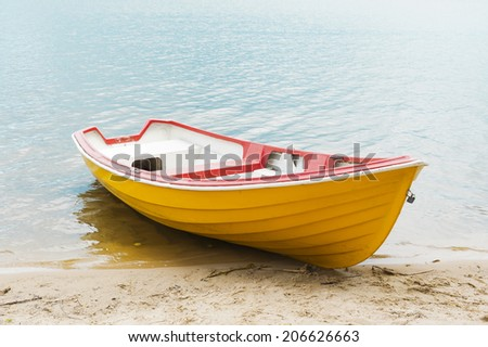 Moored boat on the lake - stock photo