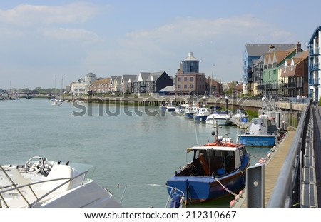 Moored boats along the River Arun at Littlehampton in West Sussex. England - stock photo