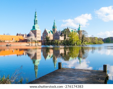 Mooring against Palace - Frederiksborg Slot is a palace in Hillerod, Denmark - stock photo