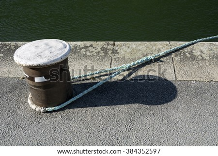 Mooring at quayside - stock photo