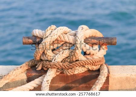 mooring rope at the sea port - stock photo