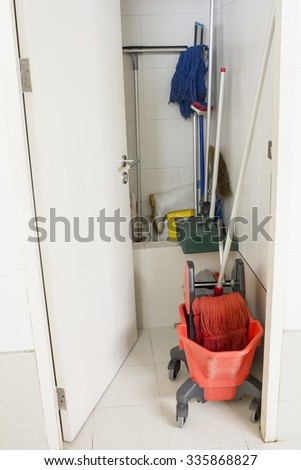 Mop bucket on cleaning in process in the room - stock photo