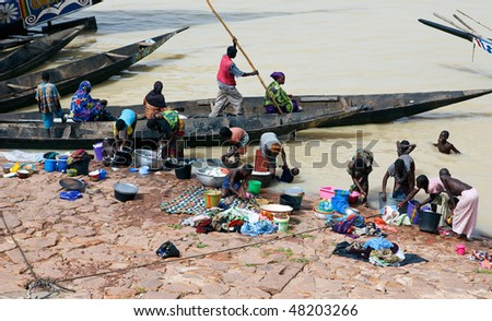 MOPTI - AUGUST 16: Women washing in the river, the lack of resources means that the population use the Niger river for washing and grooming, August 16, 2009 in Mopti, Mali - stock photo
