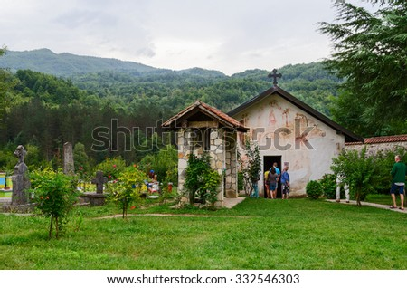 MORACA VALLEY, MONTENEGRO - SEPTEMBER 20, 2015: Unidentified tourists visit Church of St. Nicholas in Moraca Monastery, which is one of most significant Serbian medieval Orthodox monuments in Balkans - stock photo