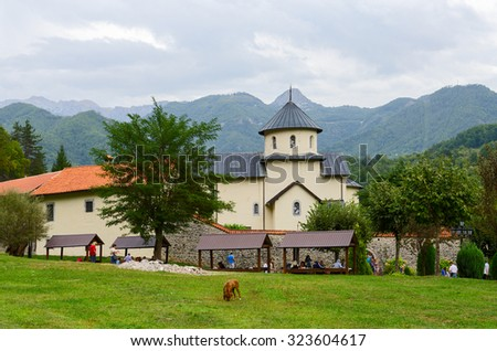 MORACA VALLEY, MONTENEGRO - SEPTEMBER 20, 2015: Unidentified tourists visit Moraca Monastery, which is one of the most significant Serbian medieval Orthodox monuments in the Balkans - stock photo