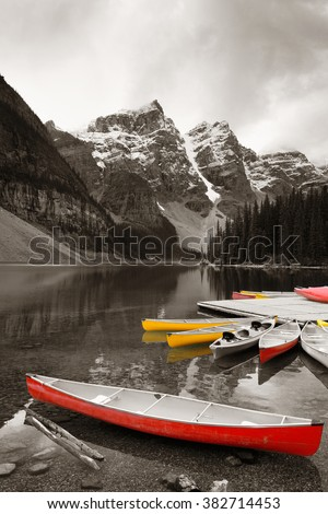 Moraine Lake and boat with snow capped mountain of Banff National Park in Canada - stock photo