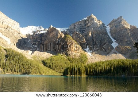 Moraine Lake, Canada, in the warm evening light under a majestic mountain range - stock photo