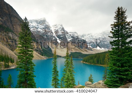 Moraine Lake with snow capped mountain of Banff National Park in Canada - stock photo