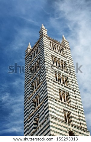 More detailed look on tower Siena Cathedral in Siena, Italy - stock photo