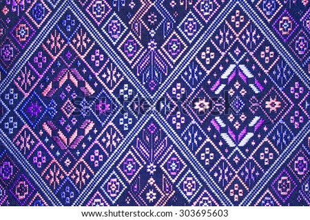 More than 100 years old colorful thai handcraft peruvian style rug surface old vintage torn conservation Made from natural materials Chemical free close up. - stock photo