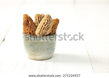 Morel Mushrooms on a white wood background.  - stock photo