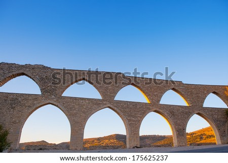 Morella aqueduct in Castellon Maestrazgo at Spain blue sky - stock photo