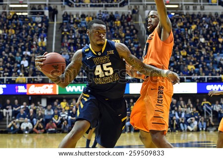 MORGANTOWN, WV - MARCH 7: West Virginia Mountaineers forward Elijah Macon (45) drives to the basket during the Big 12 Conference college basketball game March 7, 2015 in Morgantown, WV.  - stock photo