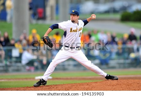 MORGANTOWN, WV - MAY 2: West Virginia pitcher Harrison Musgrave (11) deliver a pitch in one of the final baseball games at Hawley Stadium May 2, 2014 in Morgantown, WV. - stock photo