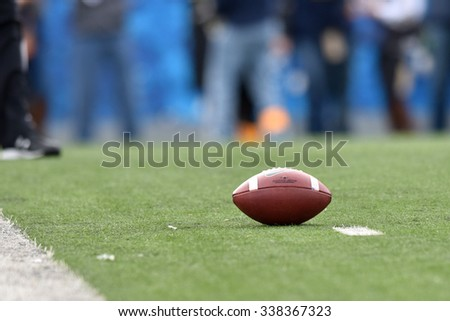 MORGANTOWN, WV - NOVEMBER 7:  A football rests on the one yard line in a timeout during the football game November 7, 2015 in Morgantown, WV. - stock photo
