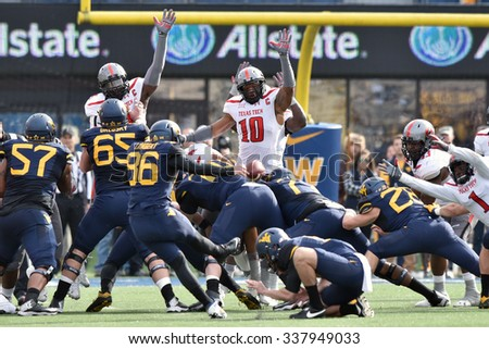 MORGANTOWN, WV - NOVEMBER 7: Texas Tech Red Raiders linebacker Pete Robertson (10) tries, unsuccessfully, to block a WVU field goal during the football game November 7, 2015 in Morgantown, WV. - stock photo
