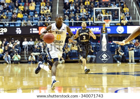MORGANTOWN, WV - NOVEMBER 13: West Virginia Mountaineers guard Teyvon Myers (0) drives to the basket for a shot during the basketball game November 13, 2015 in Morgantown, WV.  - stock photo