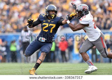 MORGANTOWN, WV - NOVEMBER 7: West Virginia Mountaineers linebacker Sean Walters (27, l) tries to fight through a block on kick coverage during the football game November 7, 2015 in Morgantown, WV. - stock photo
