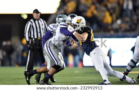 MORGANTOWN, WV - NOVEMBER 20: West Virginia Mountaineers tight end Cody Clay (88) blocks a rushing defender during the Big 12 football game November 20, 2014 in Morgantown, WV.  - stock photo