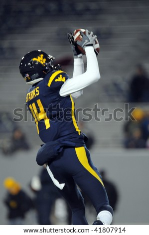 MORGANTOWN, WV - NOVEMBER 27: West Virginia University wide receiver Bradley Starks hauls in a pass during pregame warmups prior to WVU's upset 16-13 win over Pitt November 27, 2009 in Morgantown, WV - stock photo