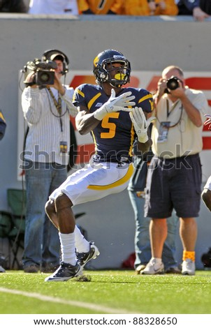 MORGANTOWN, WV - NOVEMBER 5: WVU wide receiver Ivan McCartney (#5) waits to catch a pass for a long gain in a football game against Louisville November 5, 2011 in Morgantown, WV. - stock photo