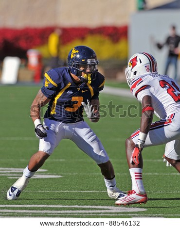MORGANTOWN, WV - NOVEMBER 5: WVU wide receiver Stedman Bailey (#3) gives a fake while running a route during the football game between Louisville and WVU November 5, 2011 in Morgantown, WV. - stock photo