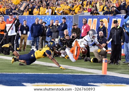 MORGANTOWN, WV - OCTOBER 10: Oklahoma State Cowboys wide receiver Jalen McCleskey (84) lunges for the endzone during the Big 12 football game October 10, 2015 in Morgantown, WV.  - stock photo