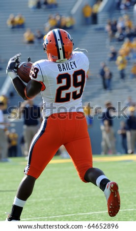 MORGANTOWN, WV - OCTOBER 23: Syracuse running back Antwon Bailey makes an over the shoulder catch during pregame drills on October 23, 2010 in Morgantown, WV. - stock photo
