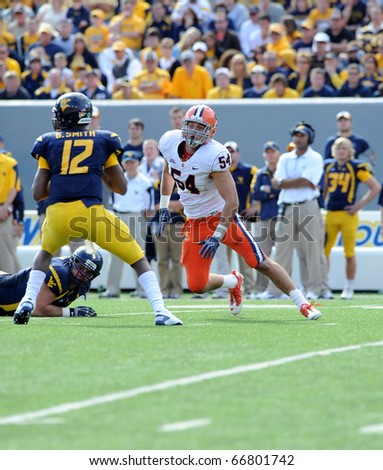 MORGANTOWN, WV - OCTOBER 23: Syracuse University linebacker Mikhail Marinovich (#54) turns the corner on a pass rush in a Big East game October 23, 2010 in Morgantown, WV. - stock photo