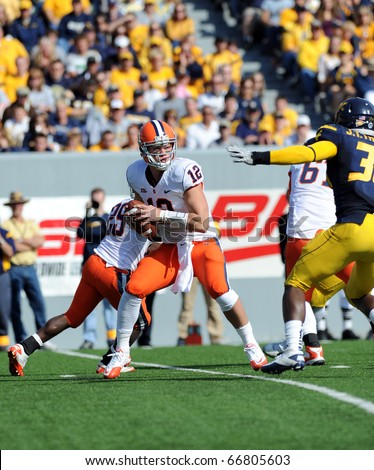 MORGANTOWN, WV - OCTOBER 23: Syracuse University quarterback Ryan Nassib (#12) drops back and spots pressure from a WVU linebacker on a pass play October 23, 2010 in Morgantown, WV. - stock photo