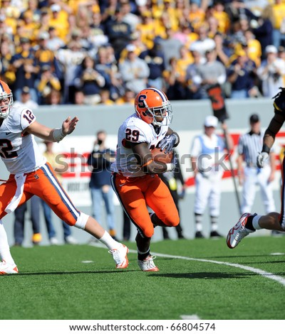MORGANTOWN, WV - OCTOBER 23: Syracuse University running back Antwon Bailey (#29) takes a handoff and looks for running room in a Big East game October 23, 2010 in Morgantown, WV. - stock photo