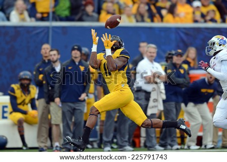 MORGANTOWN, WV - OCTOBER 4: West Virginia Mountaineers wide receiver Kevin White (11) hauls in a long pass for a touchdown during the Big 12 football game October 4, 2014 in Morgantown, WV.  - stock photo